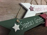 Cream Wooden Xmas Arrow Santas Grotto Plaque
